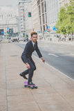 Young handsome Asian model riding his skateboard Stock Image