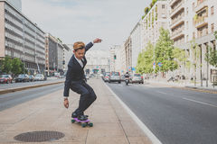 Young handsome Asian model riding his skateboard Royalty Free Stock Photos