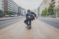 Young handsome Asian model riding his skateboard Stock Photo