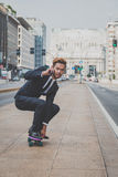 Young handsome Asian model riding his skateboard Royalty Free Stock Photography