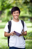 Young handsome Asian student with laptop Stock Photography
