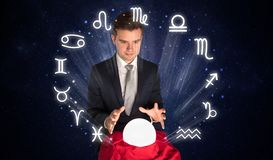 Astronaut looking for inspiration in his crystal magic ball. Young handsome astronaut looking for inspiration in his crystal magic balln royalty free stock photos