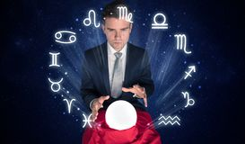 Astronaut looking for inspiration in his crystal magic ball royalty free stock photo