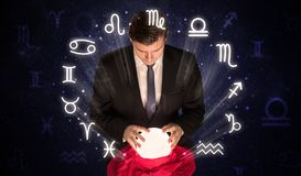 Astronaut looking for inspiration in his crystal magic ball stock image