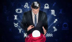 Astronaut looking for inspiration in his crystal magic ball royalty free stock photography