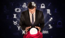 Astronaut looking for inspiration in his crystal magic ball royalty free stock images