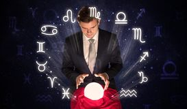 Astronaut looking for inspiration in his crystal magic ball royalty free stock image
