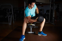 Young handsome athlete doing exercise for biceps Stock Photography