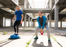 Young handsome athlete men doing exercise  in an old abandoned b Stock Photography