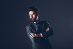 Young handsome bearded caucasian man posing indoors. Perfect skin and hairstyle. Wearing elegant jacket, jeans. Studio Royalty Free Stock Photography