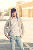 Young handsome bearded hipster man in the city instagram style Royalty Free Stock Image