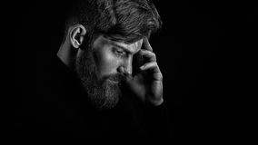 Young handsome bearded man with  beard and stylish haircut think Royalty Free Stock Image