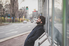 Young handsome bearded man posing in the city streets Stock Photography