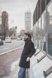 Young handsome bearded man posing in the city streets Royalty Free Stock Photography