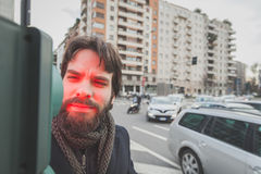Young handsome bearded man posing in the city streets Royalty Free Stock Image