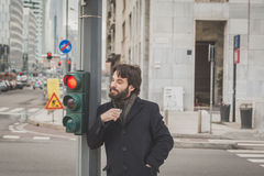 Young handsome bearded man posing in the city streets Royalty Free Stock Images