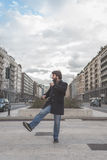 Young handsome bearded man posing in the city streets Stock Image