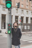 Young handsome bearded man posing in the city streets Stock Photo
