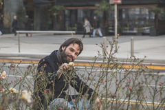 Young handsome bearded man posing in the city streets Stock Photos