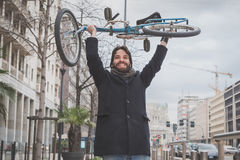 Young handsome bearded man posing with his bicyle Royalty Free Stock Photography