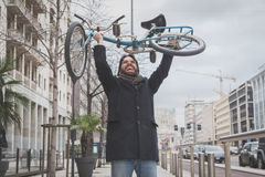 Young handsome bearded man posing with his bicyle Royalty Free Stock Photo