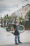 Young handsome bearded man posing with his bicyle Stock Photos