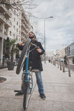 Young handsome bearded man posing with his bicyle Stock Photo