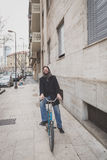 Young handsome bearded man posing with his bicyle Stock Photography
