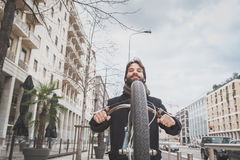 Young handsome bearded man posing with his bicyle Stock Images