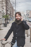 Young handsome bearded man talking on phone Royalty Free Stock Photography