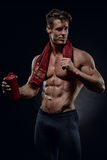 Young handsome bodybuilder drinking water Royalty Free Stock Photo