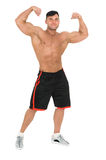 Young handsome bodybuilder man posing for fitness fashion shoot. Isolated on white. Stock Image