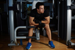 Young handsome bodybuilder resting after exercise on the pectoral muscles royalty free stock photos