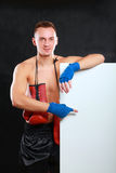 Young handsome boxer man standing near board , isolated on black background Stock Image
