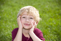 Young handsome boy daydreaming Royalty Free Stock Photography