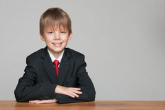 Young handsome boy at the desk Stock Photos