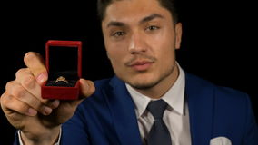 Young handsome boy friend with proposal ring in hand. Young handsome boyfriend with proposal ring in hand stock video footage