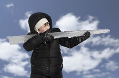 Young handsome boy with ice rifle Stock Photography