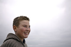 Young handsome boy with pullover at beach winter Royalty Free Stock Photos