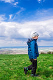 Young handsome boy walking on green grass Stock Images