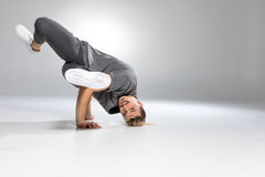 Young handsome breakdancer. Dancing on white and smiling Stock Photos