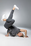 Young handsome breakdancer. Dancing on white and smiling Royalty Free Stock Photo