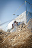 Young handsome bridal couple sharing a kiss outdoors Royalty Free Stock Image