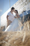 Young handsome bridal couple sharing a moment outdoors Stock Photos