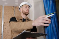 Young handsome builder holding clipboard Stock Photography
