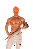 Young and handsome builder with a sledgehammer and Royalty Free Stock Photos