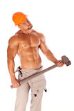 Young and handsome builder with a sledgehammer and Stock Images
