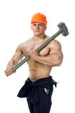 Young and handsome builder with a sledgehammer and sexy body Royalty Free Stock Images