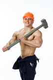Young and handsome builder with a sledgehammer and sexy body Stock Photo