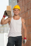 Young Handsome Builder With Wood Planks Royalty Free Stock Photo